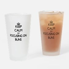 Keep Calm by focusing on Buns Drinking Glass