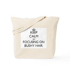 Keep Calm by focusing on Bushy Hair Tote Bag