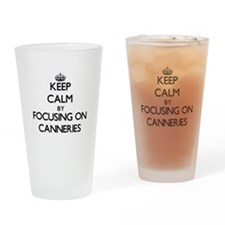 Keep Calm by focusing on Canneries Drinking Glass