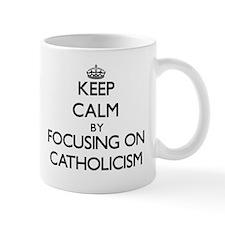 Keep Calm by focusing on Catholicism Mugs