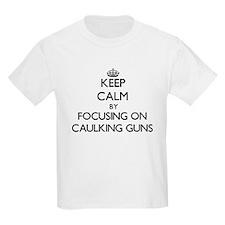 Keep Calm by focusing on Caulking Guns T-Shirt