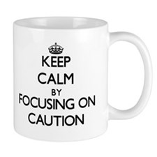 Keep Calm by focusing on Caution Mugs
