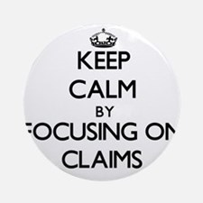 Keep Calm by focusing on Claims Ornament (Round)