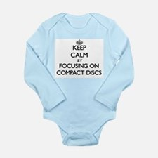 Keep Calm by focusing on Compact Discs Body Suit