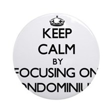 Keep Calm by focusing on Condomin Ornament (Round)