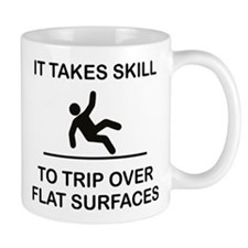 IT TAKES SKILL TO TRIP OVER FLAT SURFACES. Mugs