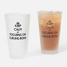 Keep Calm by focusing on Curling Ir Drinking Glass