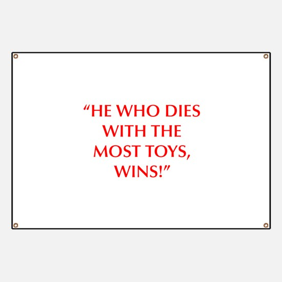 HE WHO DIES WITH THE MOST TOYS WINS Banner