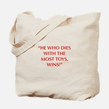 HE WHO DIES WITH THE MOST TOYS WINS Tote Bag