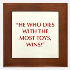 HE WHO DIES WITH THE MOST TOYS WINS Framed Tile