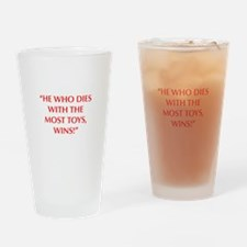 HE WHO DIES WITH THE MOST TOYS WINS Drinking Glass