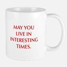 MAY YOU LIVE IN INTERESTING TIMES Mugs