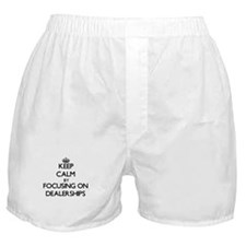 Keep Calm by focusing on Dealerships Boxer Shorts