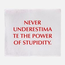 NEVER UNDERESTIMATE THE POWER OF STUPIDITY Throw B