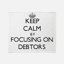 Keep Calm by focusing on Debtors Throw Blanket
