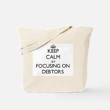 Keep Calm by focusing on Debtors Tote Bag