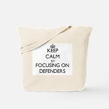 Keep Calm by focusing on Defenders Tote Bag