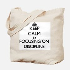 Keep Calm by focusing on Discipline Tote Bag