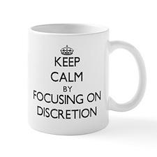 Keep Calm by focusing on Discretion Mugs