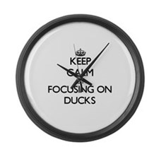 Keep Calm by focusing on Ducks Large Wall Clock