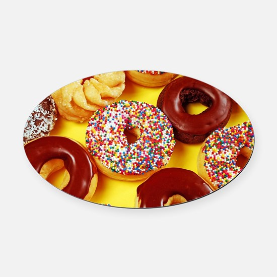 Assorted delicious donuts Oval Car Magnet