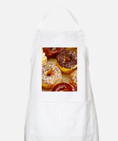 Assorted delicious donuts Apron