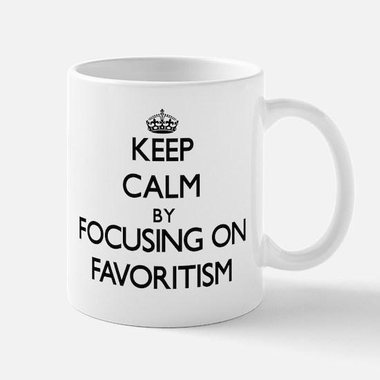 Keep Calm by focusing on Favoritism Mugs