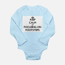 Keep Calm by focusing on Footsteps Body Suit