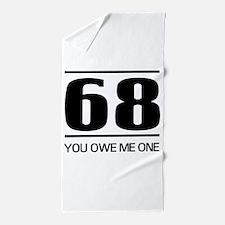 68 you owe me one Beach Towel