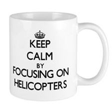 Keep Calm by focusing on Helicopters Mugs