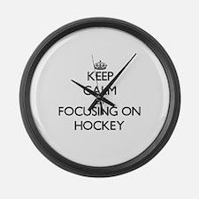 Keep Calm by focusing on Hockey Large Wall Clock