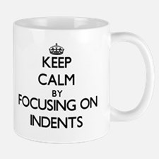 Keep Calm by focusing on Indents Mugs