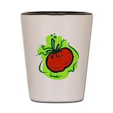 tomato on bold green background Shot Glass