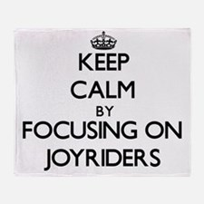 Keep Calm by focusing on Joyriders Throw Blanket