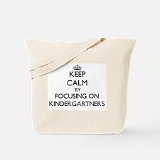 Keep Calm by focusing on Kindergartners Tote Bag