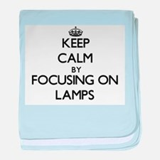 Keep Calm by focusing on Lamps baby blanket