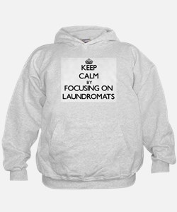 Keep Calm by focusing on Laundromats Hoodie