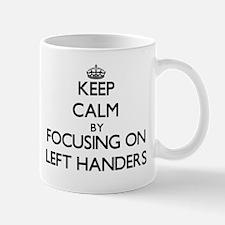 Keep Calm by focusing on Left Handers Mugs