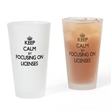 Keep Calm by focusing on Licenses Drinking Glass