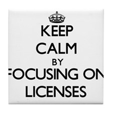 Keep Calm by focusing on Licenses Tile Coaster