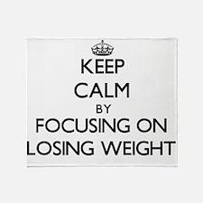 Keep Calm by focusing on Losing Weig Throw Blanket