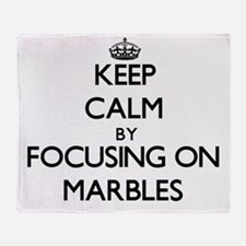 Keep Calm by focusing on Marbles Throw Blanket