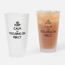 Keep Calm by focusing on Mercy Drinking Glass