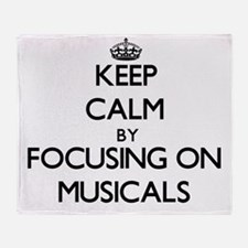 Keep Calm by focusing on Musicals Throw Blanket