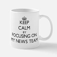 Keep Calm by focusing on My News Team Mugs