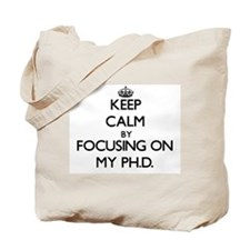 Keep Calm by focusing on My Ph.D. Tote Bag