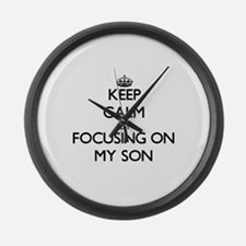 Keep Calm by focusing on My Son Large Wall Clock