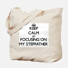 Keep Calm by focusing on My Stepfather Tote Bag