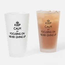 Keep Calm by focusing on Never Givi Drinking Glass