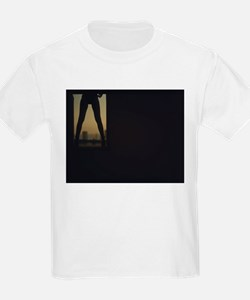 Young lady in high heel shoes in silhouett T-Shirt